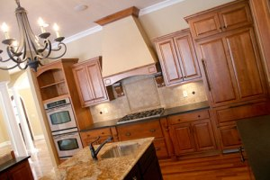 Custom Kitchen, Double Ovens, Custom-Built Wood Cabinetry & Trim, Hidden Refrigerator; Luxury Home Builders, Indianapolis, Central Indiana - Madison Custom Homes Inc.