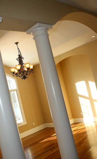 Luxury Home Dining Room, Column Entry, Wrought Iron Chandelier, Hardwood Floor - Madison Custom Homes Inc., Indianapolis, Central Indiana