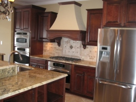 Custom Home Kitchen, Wall-Mounted Double Stack Ovens, Custom Range Hood, Custom Wood Cabinetry, Stainless Steel Appliances - Madison Custom Homes Inc., Indianapolis, Indiana