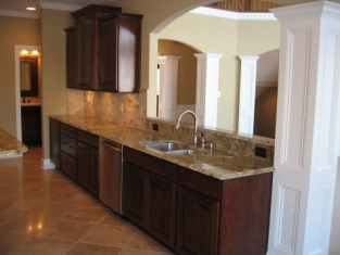 Custom Home Kitchen: Stained Wood Cabinetry, Dining Room Pass-Through, Granite Countertops, Madison Custom Homes Inc., Indianapolis, Indiana
