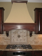 Custom Home Kitchen: Custom Range Hood, Brick Backsplash, Mosaic Tile Backsplash, Granite Countertops, Built-In Stovetop, Indianapolis, Indiana