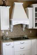 Carmel, Indiana Custom Home Kitchen, Flat-Panel Stovetop, Granite Counters, Faux-Brick Backsplash, Glass-Front Cabinets, Hardwood Floors; - Madison Custom Homes Inc., Indianapolis, Indiana