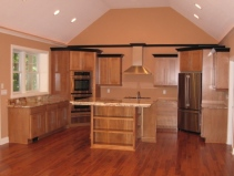 Custom Home Kitchen, Wall-mounted Double Stack Ovens, Granite Counters, Hardwood Floor, Custom Range Hood, Center Island - Madison Custom Homes Inc., Indianapolis, Indiana