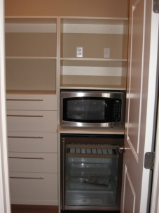 Custom Home Kitchen, Pantry Closet, Storage Drawers, Hide-Away Microwave Oven, Glass Door Wine Bottle Cooler - Madison Custom Homes Inc., Indianapolis, Indiana