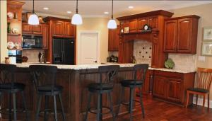 Breakfast Bar, Open Kitchen, Matching Black Bar Stools &, Kitchen Appliances, Matching Stained Wood Cabinets & Floor