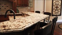 Close-Up of Granite Breakfast Bar, Matching Black Bar Stools &, Kitchen Appliances, Matching Stained Wood Cabinets & Floor