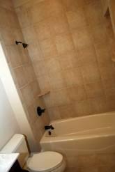 Master Bathroom Tub, Granite Tile / Soap Dish, Antique Brass Finish Plumbing Fixtures