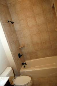 Master Bathroom Tub, Granite Tile / Soap Dish, Antique Brass Finish Plumbing Fixtures