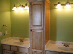 Guest Bathroom, Dual Sinks, Storage / Medicine Cabinet Center Column, Wall Sconce Lighting, Luxury Home Builder, Indianapolis, Indiana, Madison Custom Homes Inc.