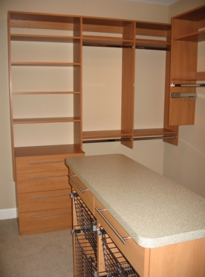 Master Bedroom Walk-In Closet: Custom-Built Wood Shelving, Dressing Room Counter, Custom Luxury Homes, Indianapolis, Indiana