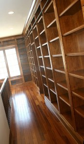 Architectural Design Detail: Library. Custom-Built Bookcases, Sliding Ladder Rail, Hardwood Floors; Homes Built to Your Specifications, Indianapolis, Indiana - Madison Custom Homes Inc.
