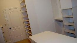 Master Bedroom Walk-In Closet: Custom-Built Wood Shelving, Dressing Room Counter
