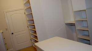 Master Bedroom Walk-In Closet: Custom-Built Wood Shelving, Dressing Room Counter