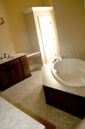 Master Bath Oval Whirlpool Tub, Tile / Hardwood Platform Enclosure, Large Linen / Storage Closet