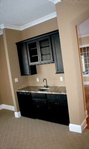 Wet Bar in Family Room, Built-In Glass Racks, Granite Counter, Wall-Mounted Cabinet