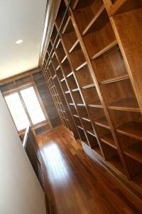 Library Architecture: Custom-Built Bookcases, Sliding Ladder Rail, Hardwood Floors