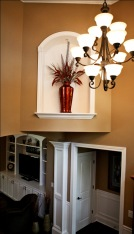 Wrought Iron Chandelier in Foyer, Arched Wall Alcove