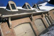 Attached 3-Car Brick Garage, Custom Doors, Skylights
