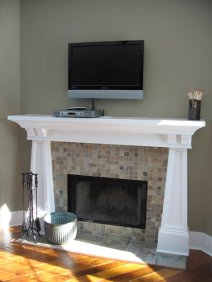 Tiled Fireplace, Carved Wood Mantle, Wall-Mounted Flat Screen TV