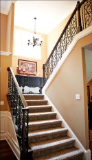 Luxury Home Foyer: Design Detail Close-up, Wrought Iron and Oak Banisters, Crown Molding Accent; Luxury Homes Built to Your Specifications; Indianapolis, Indiana - Madison Custom Homes Inc.