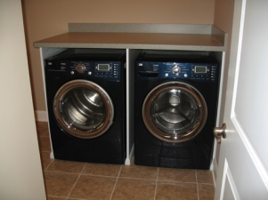 Custom-Built Luxury Home Laundry Room, Large Capacity, Front-Loading Washer and Dryer: Indianapolis, Indiana - Madison Custom Homes Inc.