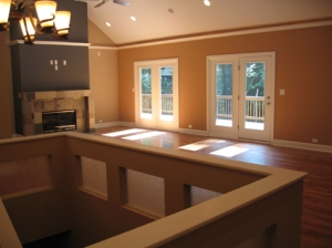 Luxury Home Great Room, Ceiling Fan, Custom Stone Fireplace, Double Glass Doors Open to Rear Deck, Recessed Lighting, Hardwood Floor, Carmel, Indiana - Madison Custom Homes Inc.