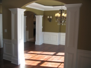 Design Detail: Arched Dining Room Entryways, Hand-Crafted Columns, Crystal Chandelier, Wall Sconces, Luxury Home Builder, Indianapolis, Indiana
