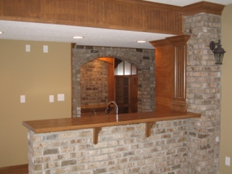 Luxury Home Noblesville: Basement, Custom-Built Wet Bar, Brick Face, Oak Bar Top and Accents - Madison Custom Homes Inc., Indianapolis, Indiana