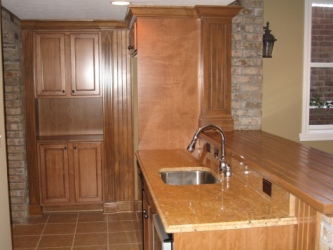 Luxury Home Noblesville: Basement, Custom-Built Wet Bar, Granite-Topped Sink Counter, Brick Face, Oak Bar Top / Cabinets - Madison Custom Homes Inc., Indianapolis