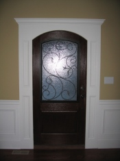 Design Detail: Decorative Custom Mahogany Front Door, Hand-Crafted Glass Panel, Luxury Home Builder - Madison Custom Homes, Indianapolis, Indiana