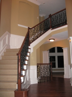 Luxury Home Foyer: Design Detail, Wrought Iron and Oak Banisters, Crown Molding Accent; Luxury Homes Built to Your Specifications; Indianapolis, Indiana - Madison Custom Homes Inc.