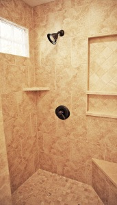 Walk-In Shower in Master Bathroom, Granite Tile, Built-In Toiletry Shelves
