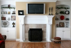 Custom Home Family Room, Flat Screen TV Mounted Over Fireplace, Hand-Carved Mantle, Built-in Bookcase / Cabinets; Indianapolis, Indiana - Madison Custom Homes Inc.