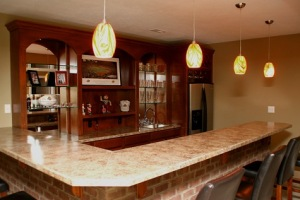 Luxury Home Noblesville: Basement, Custom-Built Wet Bar, Brick Face, Marble Top, Mirrored Shelves, Refrigerator, Drop Lighting - Madison Custom Homes Inc., Indianapolis, Indiana