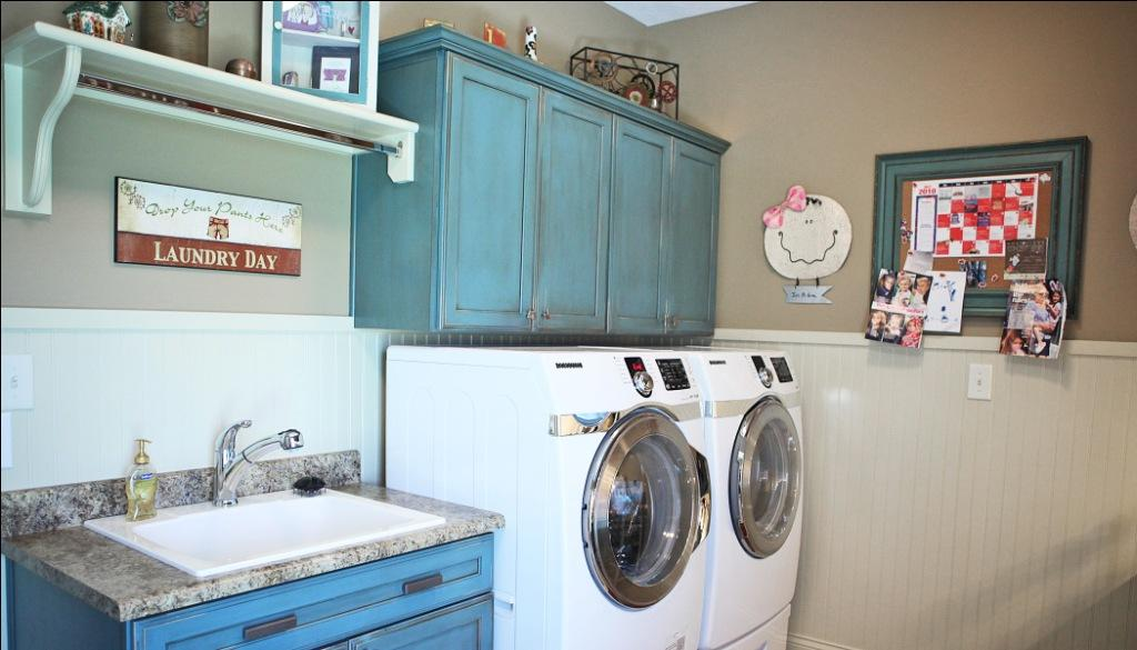 Custom Built Luxury Home Laundry Room Utility Sink Counter Folding Table Hanging Rack Wall Mounted Storage Cabinets Luxury Homes Indianapolis Indiana Custom Luxury Home Builder Central Indiana Madison Custom Homes Indianapolis Carmel