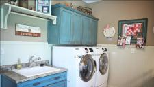 Custom-Built Luxury Home Laundry Room: Utility Sink Counter, Folding Table, Hanging Rack, Wall Mounted Storage Cabinets, Luxury Homes, Indianapolis, Indiana