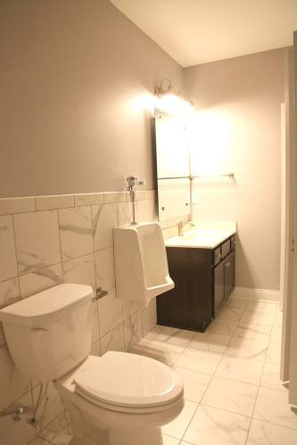 Bathroom with Urinal in Central Indiana Custom Home built by Madison Custom Homes Inc.