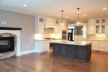 Kitchen Island Connects Family Room (with Fireplace) to Kitchen in Custom Home in Central Indiana built by Madison Custom Homes Inc.