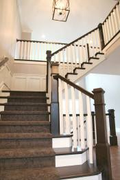 Staircase and Chandelier in Central Indiana Custom Home built by Madison Custom Homes Inc.